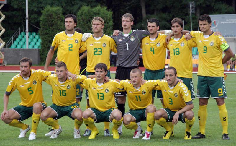 Lithuania-10-11-hummel-home-kit-yellow-green-yellow-pose.jpg